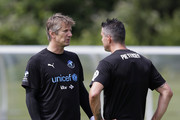 Edwin Van Der Sar and Kevin Pietersen of the Rest of the World in discussion as they take part in training during Soccer Aid for UNICEF media access at Fulham FC training ground on June 8, 2018 in New Malden, England.