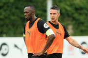 Usain Bolt and Kevin Pietersen of the Rest of the World take part in training during a Soccer Aid for UNICEF media session at Fulham FC training ground on June 7, 2018 in New Malden, England.