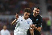 Myles Stephenson of England and Kevin Pietersen of the Rest of the World battle for the ball during the Soccer Aid for UNICEF 2018 match between Englannd and the Rest of the World at Old Trafford on June 10, 2018 in Manchester, England.