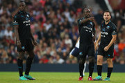 Clarence Seedorf of the Rest of the World (C) celebrates as he scores their third goal with Usain Bolt of the Rest of the World (L) and Martin Compston of the Rest of the World (R) during the Soccer Aid for UNICEF 2018 match between Englannd and the Rest of the World at Old Trafford on June 10, 2018 in Manchester, England.