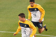 Harry Kewell and Tim Cahill of Australia warm up during an Australian Socceroos training session at Ruimsig Stadium on June 8, 2010 in Sandton, South Africa.