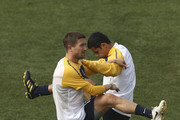 Harry Kewell and Tim Cahill of Australia warm up during an Australian Socceroos training session at St Stithians College on May 31, 2010 in Sandton, South Africa.