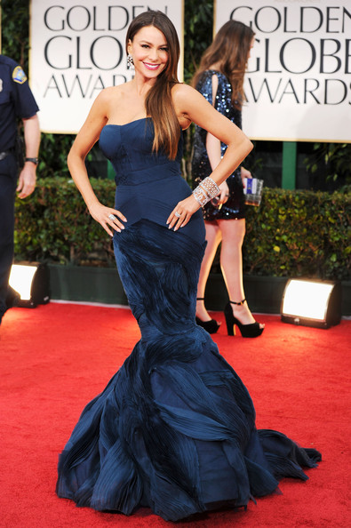 69th Annual Golden Globe Awards - Arrivals [red carpet,dress,clothing,gown,carpet,shoulder,flooring,fashion,strapless dress,hairstyle,arrivals,sofia vergara,beverly hills,california,beverly hilton hotel,golden globe awards,69th annual golden globe awards]