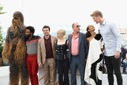 """(L-R) Chewbacca (in costume), Actors Donald Glover, Alden Ehrenreich, Emilia Clarke, director Ron Howard, actors  Woody Harrelson, Thandie Newton and Joonas Suotamo attend the photocall for """"Solo:  A Star Wars Story"""" during the 71st annual Cannes Film Festival at Palais des Festivals on May 15, 2018 in Cannes, France."""