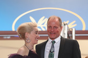 """Actors Emilia Clarke and Woody Harrelson depart the screening of """"Solo: A Star Wars Story"""" during the 71st annual Cannes Film Festival at Palais des Festivals on May 15, 2018 in Cannes, France."""