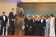 """(L-R) Actor Joonas Suotamo, Chewbacca, actor Woody Harrelson, director Ron Howard, actress Emilia Clarke, actor Alden Ehrenreich, actor Donald Glover, actress Phoebe Waller-Bridge, actor Paul Bettany and producer Kathleen Kennedy attend the screening of """"Solo: A Star Wars Story"""" during the 71st annual Cannes Film Festival at Palais des Festivals on May 15, 2018 in Cannes, France."""