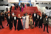 """Actors Woody Harrelson, Alden Ehrenreich, Emilia Clarke, Donald Glover, Phoebe Waller-Bridge, Thandie Newton, Joonas Suotamo, producer Simon Emanuel, writer Lawrence Kasdan and Jonathan Kasdan depart the screening of """"Solo: A Star Wars Story"""" during the 71st annual Cannes Film Festival at Palais des Festivals on May 15, 2018 in Cannes, France."""