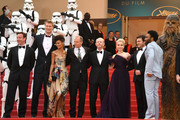 """(L-R) Producer Simon Emanuel, Joonas Suotamo, Thandie Newton, Woody Harrelson, Cannes Film Festival Director Thierry Fremaux,  Ron Howard, Emilia Clarke, Alden Ehrenreich, Donald Glove and Chewbacca (in costume)attends the screening of """"Solo: A Star Wars Story"""" during the 71st annual Cannes Film Festival at Palais des Festivals on May 15, 2018 in Cannes, France."""