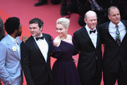 """Actors Alden Ehrenreich, Donald Glover, Emilia Clarke, director Ron Howard and actor Woody Harrelson attend the screening of """"Solo: A Star Wars Story"""" during the 71st annual Cannes Film Festival at Palais des Festivals on May 15, 2018 in Cannes, France."""