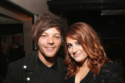 Recording artists Louis Tomlinson (L) and Meghan Trainor attend Sony Music Entertainment 2016 Post-Grammy Reception at Hotel Bel Air on February 15, 2016 in Los Angeles, California.