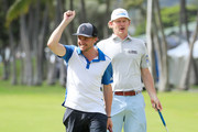 Actor Tom Felton and Brandt Snedeker of the United States react during the pro-am prior to the Sony Open in Hawaii at the Waialae Country Club on January 08, 2020 in Honolulu, Hawaii.