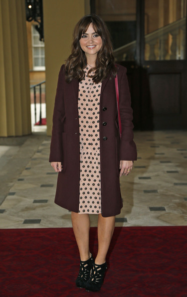 British actress Jenna Coleman currently in the role of 'Clara Oswald' in the BBC One British television series 'Doctor Who', poses for photographers as she arrives for a reception to mark the 50th anniversary of the hit TV series at Buckingham Palace on November 18, 2013 in London, England. Sophie, Countess of Wessex hosted a reception to mark the 50th anniversary of the TV series in which there have been 11 Doctors to date. It now holds the Guinness World Record for the longest running science fiction series in the world.