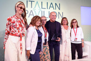 Ferzan Ozpetek (C) receives his award with Nina Zilli (L) and Laura Delli Colli (second left) and guests at the Soundtrack Awards during the 76th Venice Film Festival at Excelsior Hotel on September 04, 2019 in Venice, Italy.