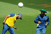 Imran Tahir heads the ball in a game of football while Hashim Amla looks on during a South African nets session at Basin Reserve on March 10, 2015 in Wellington, New Zealand.