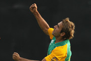 Imran Tahir of South Africa celebrates the wicket of David Hussey of Australia during the 2011 ICC World Cup warm up game between South Africa and Australia at the M. Chinnaswamy Stadium on February 15, 2011 in Bangalore, India.