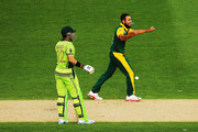 Imran Tahir of South Africa celebrates the wicket of Wahab Riaz of Pakistan during the 2015 ICC Cricket World Cup match between South Africa and Pakistan at Eden Park on March 7, 2015 in Auckland, New Zealand.