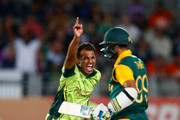 Wahab Riaz  of Pakistan (L) celebrates his wicket of Imran Tahir of South Africa (R) to win the match  during the 2015 ICC Cricket World Cup match between South Africa and Pakistan at Eden Park on March 7, 2015 in Auckland, New Zealand.