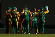 Imran Tahir of South Africa celebrates with team mates after dismissing Mahela Jayawardene of Sri Lanka during the 2015 ICC Cricket World Cup match between South Africa and Sri Lanka at Sydney Cricket Ground on March 18, 2015 in Sydney, Australia.