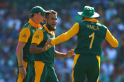 Imran Tahir of South Africa celebrates taking the wicket of Mahela Jayawardene of Sri Lanka with Hashim Amla of South Africa during the 2015 ICC Cricket World Cup match between South Africa and Sri Lanka at Sydney Cricket Ground on March 18, 2015 in Sydney, Australia.