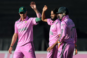 Imran Tahir celebrates a wicket with Dale Steyn and AB de Villiers of South Africa during the 2nd Momentum ODI between South Africa and West Indies at Bidvest Wanderers Stadium on January 18, 2015 in Johannesburg, South Africa.