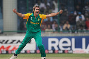 Imran Tahir of South Africa celebrates the wicket of Sarwan of West Indies during the 2011 ICC World Cup Group B match between West Indies and South Africa at Feroz Shah Kotla Stadium on February 24, 2011 in Delhi, India.