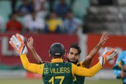 Imran Tahir of the Proteas celebrates the wicket of Jonathan Carter of the West Indies with AB de Villiers of the Proteas during the 1st Momentum ODI between South Africa and West Indies at Sahara Stadium Kingsmead on January 16, 2015 in Durban, South Africa.