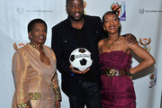 South African Consul General Fikile Magubane, actor Malik Yoba and singer Celia Faussart of Les Nubians celebrate the launch of the new FIFA collections brand of apparel and accessories at South African Consulate on December 4, 2009 in New York City.