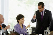 South Korean President Park Geun-hye shares a champagne toast with California Governor Jerry Brown (L) and Los Angeles Mayor Antonio Villaraigosa (R) during a welcoming luncheon at Getty House on May 9, 2013 in Los Angeles, California. Park will visit Korean business leaders in Los Angeles today as she continues a five-day, unity-building visit to the United States. Park has been in the United States since Monday, when she visited the United Nations. She met with President Barack Obama on Tuesday and addressed a joint session of Congress on Wednesday