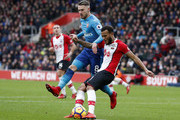 Southampton's English defender Ryan Bertrand (R) clears the ball from Arsenal's Welsh midfielder Aaron Ramsey during the English Premier League football match between Southampton and Arsenal at St Mary's Stadium in Southampton, southern England on December 10, 2017. / AFP PHOTO / Adrian DENNIS / RESTRICTED TO EDITORIAL USE. No use with unauthorized audio, video, data, fixture lists, club/league logos or 'live' services. Online in-match use limited to 75 images, no video emulation. No use in betting, games or single club/league/player publications.  /