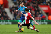 Aaron Ramsey of Arsenal an Pierre-Emile Hojbjerg of Southampton during the Premier League match between Southampton and Arsenal at St Mary's Stadium on December 10, 2017 in Southampton, England.