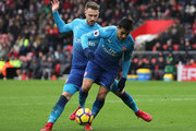 Alexis Sanchez and Aaron Ramsey of Arsenal clash during the Premier League match between Southampton and Arsenal at St Mary's Stadium on December 9, 2017 in Southampton, England.