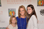 Cat Young, actress Cheryl Hines and Kyra Kennedy attend A Day of Beauty for Their Best Buddies at Blushington Make-Up and Beauty Lounge on March 12, 2013 in West Hollywood, California.