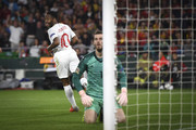Raheem Sterling celebrates his second goal as David de Gea looks on during the UEFA Nations League A group four match between Spain and England at Estadio Benito Villamarin on October 15, 2018 in Seville, Spain.