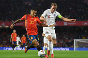 Thiago Alcantara of Spain battles with Harry Kane of England during the UEFA Nations League A Group Four match between Spain and England at Estadio Benito Villamarin on October 15, 2018 in Seville, Spain.