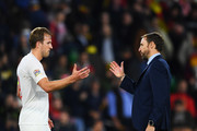 Gareth Southgate, Manager of England and Harry Kane of England celebrate victory after the UEFA Nations League A Group Four match between Spain and England at Estadio Benito Villamarin on October 15, 2018 in Seville, Spain.