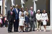 (L-R) Jesus Ortiz, King Felipe VI of Spain, Princess Sofia of Spain, Queen Sofia, Princess Leonor of Spain, Queen Letizia of Spain, King Juan Carlos, Menchu Alvarez and Paloma Rocasolano pose for the photographers after the First Communion of Princess Leonor of Spain at the Asuncion de Nuestra Senora Church on  on May 20, 2015 in Madrid, Spain.