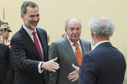 King Felipe VI of Spain (L) and King Juan Carlos (R) attend a meeting with COTEC Foundation at the Royal Palace on May 14, 2019 in Madrid, Spain.