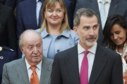 King Felipe VI of Spain (R) and King Juan Carlos (L) attend a meeting with COTEC Foundation at the Royal Palace on May 14, 2019 in Madrid, Spain.