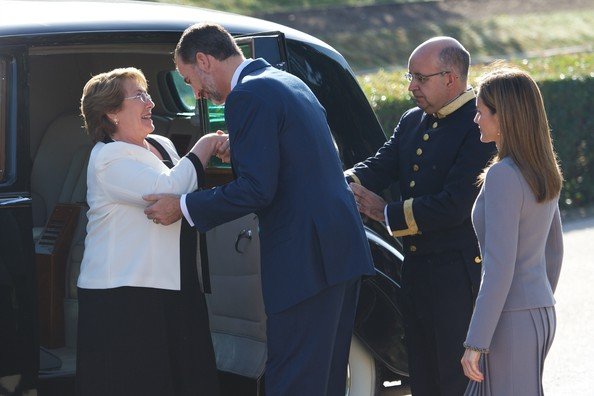King Felipe VI of Spain (C) and Queen Letizia of Spain (R) receive Chilean President Michelle Bachelet (L) at the El Pardo Palace on October 29, 2014 in Madrid, Spain.