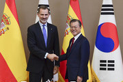 King Felipe VI (L) of Spain and South Korean President Moon Jae-in (R) shake hands prior to their meeting at the presidential Blue House on October 23, 2019 in Seoul, South Korea. King Felipe VI of Spain and Queen Letizia of Spain are visiting South Korea for two days to discuss bilateral cooperation in sectors including economy and trade.