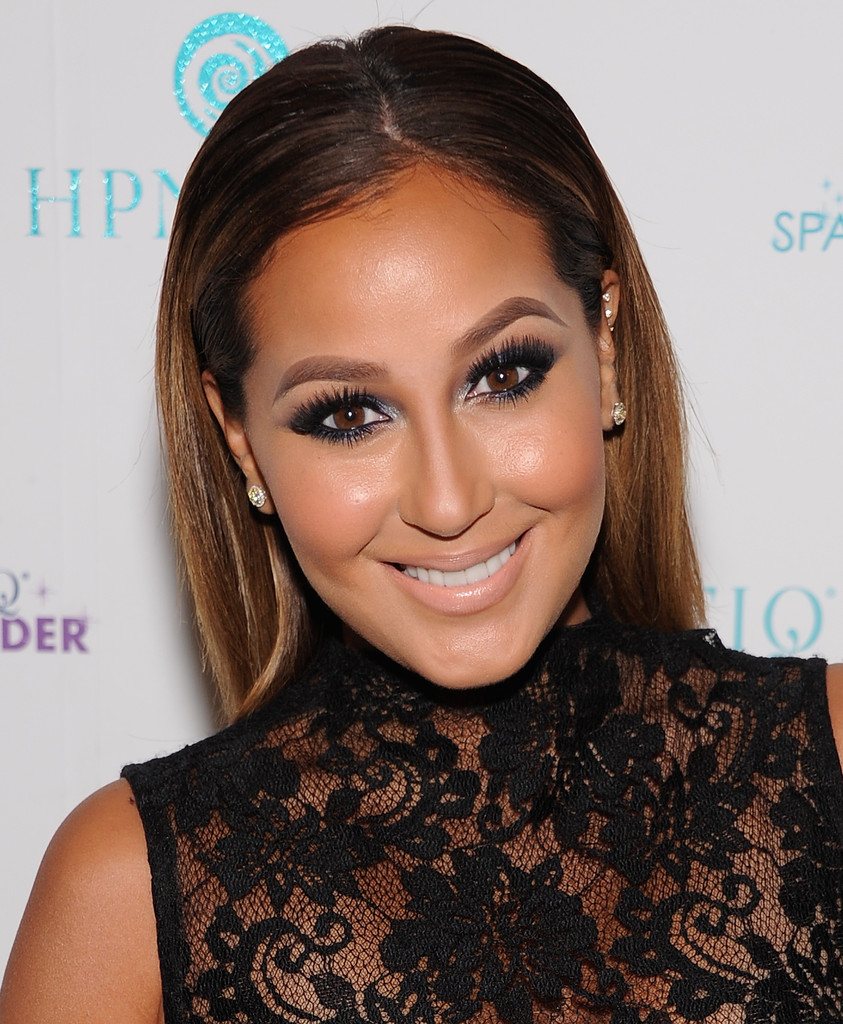 Adrienne Bailon attends the 'Sparkle Louder' Launch Event at 18 9th Avenue on November 26, 2013 in New York City.