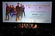 """(L-R) Henry Golding, Michelle Dockery, Hugh Grant, Charlie Hunnam, Matthew McConaughey, Guy Ritchie, and Tim League speak onstage during the Special NY Screening of """"The Gentlemen"""" at the Alamo Drafthouse on January 11, 2020 in New York City."""