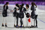 Gold medalists Miho Takagi, Ayaka Kikuchi, Ayano Sato and Nana Takagi of Japan celebrate with bronze medalists Heather Bergsma, Brittany Bowe, Mia Manganello and Carlijn Schoutens of the United States after the Speed Skating Ladies' Team Pursuit Finals on day 12 of the PyeongChang 2018 Winter Olympic Games at Gangneung Oval on February 21, 2018 in Gangneung, South Korea.