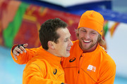 Stefan Groothuis of the Netherlands celebrate with Michel Mulder of the Netherlands after the Men's 1000m Speed Skating event during day 5 of the Sochi 2014 Winter Olympics at at Adler Arena Skating Center on February 12, 2014 in Sochi, Russia.