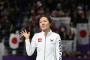 Silver medalist Sang-Hwa Lee of Korea celebrates during the victory ceremony after the Ladies' 500m Individual Speed Skating Final on day nine of the PyeongChang 2018 Winter Olympic Games at Gangneung Oval on February 18, 2018 in Gangneung, South Korea.
