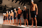 Swimmers, Katie Hoff, Nathan Adrian, Dana Vollmer, Ryan Lochte,  Natalie Coughlin, Tyler Clary, Jessica Hardy, Ryan Cochrane and Michael Phelps pose for a photo during a press conference to debut the new Speedo FASTSKIN 3 at Skylight Studios on November 30, 2011 in New York City.