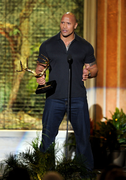 "Actor Dwayne Johson accepts the Biggest Ass-Kicker award onstage during Spike TV's 5th annual 2011 ""Guys Choice"" Awards at Sony Pictures Studios on June 4, 2011 in Culver City, California."