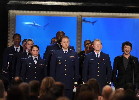 Actor Robert Downey Jr. (R) and United States military members the speak onstage during Spike TV's 4th Annual