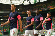 (L-R)  Stephan Lichteiner, Rob Holding, Danny Welbeck and Aaron Ramsey of Arsenal FC look on during the warm up prior to  the UEFA Europa League Group E match between Sporting CP and Arsenal at Estadio Jose Alvalade on October 25, 2018 in Lisbon, Portugal.