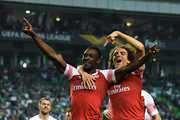 Danny Welbeck of Arsenal celebrates with Matteo Guendouzi of Arsenal after scoring his sides first goal during the UEFA Europa League Group E match between Sporting CP and Arsenal at Estadio Jose Alvalade on October 25, 2018 in Lisbon, Portugal.